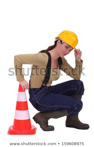 craftswoman kneeling next to a traffic cone Stock photo © photography33
