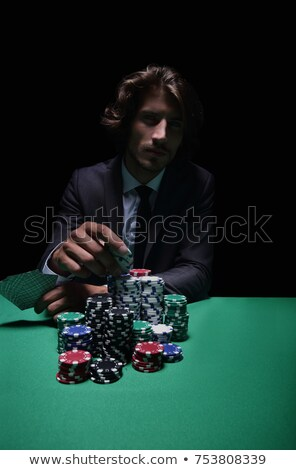 Young man holding up his cards during a game Stock photo © photography33
