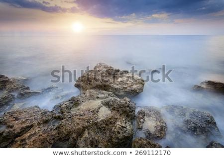 L'esposizione a lungo rocce mare spiaggia acqua estate Foto d'archivio © yuliang11