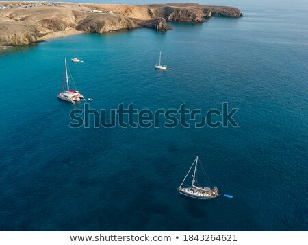 Canary Islands brown sand beach turquoise water Stock photo © lunamarina