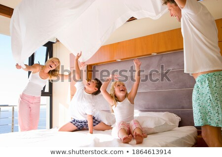 two parents and their two children in front of the sea Stock photo © photography33