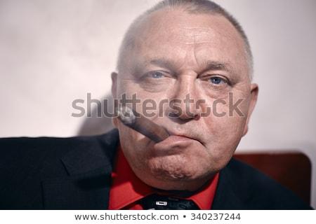 érett üzletember dohányzás szivar iroda kéz Stock fotó © photography33