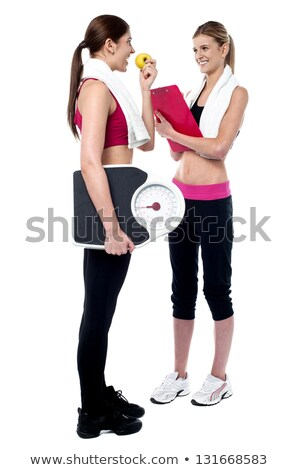 Female gym instructor writing diet chart Stock photo © stockyimages