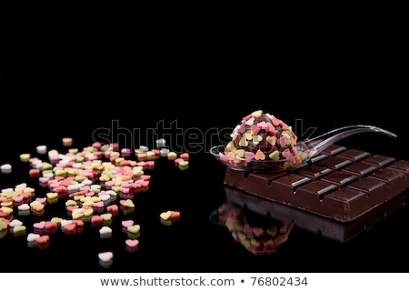 chocolate - colored brigadier, on black with reflexion Stock photo © alexandrenunes
