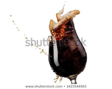 glass of dark beer on a white Stock photo © shutswis