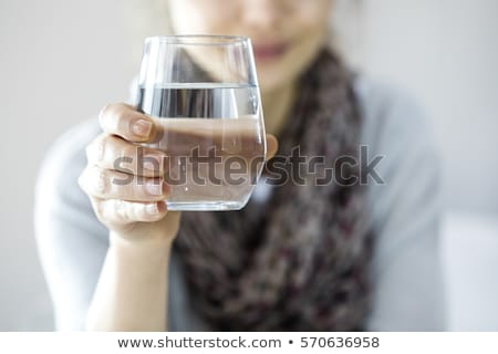 Woman holding glass of water Stock photo © photography33