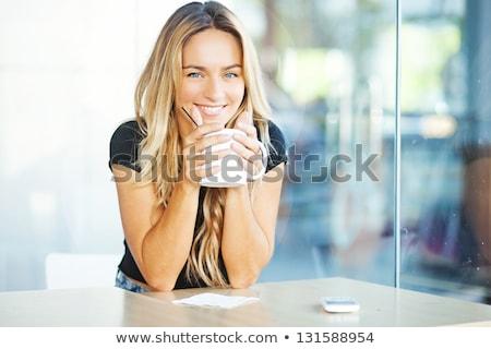 ブロンド 女性 カップ ホットドリンク 座って ストックフォト © vankad