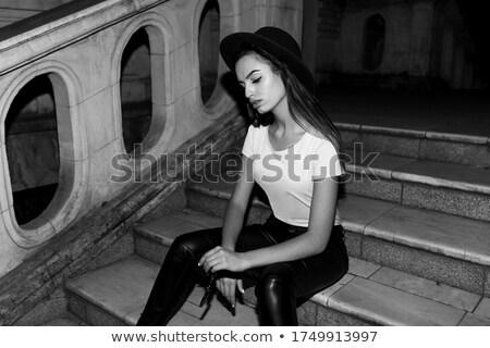 Fiatal nő kalap napszemüveg lefelé fehér égbolt Stock fotó © SophieJames