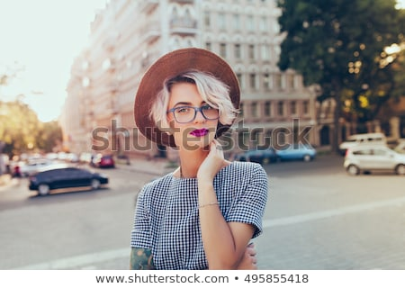 Woman in checkered dress posing Stock photo © vetdoctor