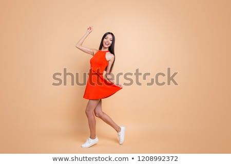 Woman in nice dress jumping on background Stock photo © vetdoctor