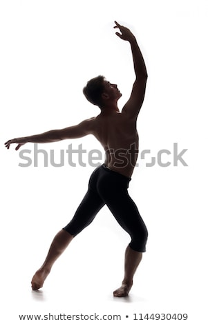 young man in topless looking up to the light and raising arm - sign of faith  Stock photo © alexandrenunes