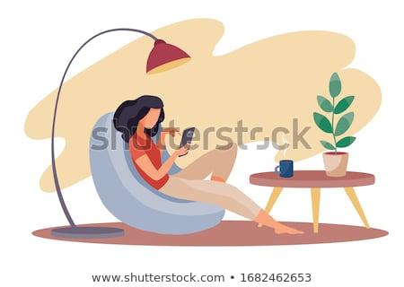 Lány ül kanapé lámpa aranyos barna hajú Stock fotó © feelphotoart