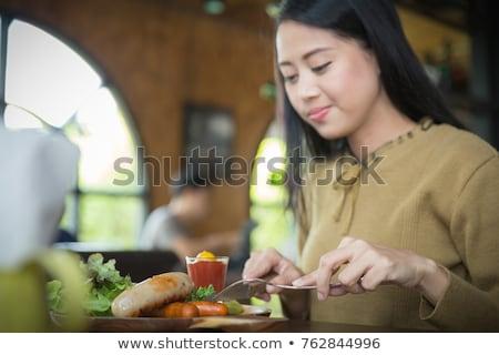 Kız sosis yeme ışık köpek akşam yemeği Stok fotoğraf © ddvs71