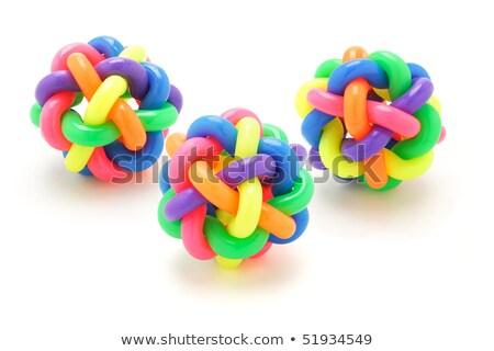 macro image of interlocked multicolor rubber rings stock photo © dezign56
