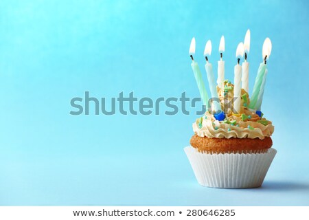 delicious birthday cupcake on table with candles stock photo © meinzahn