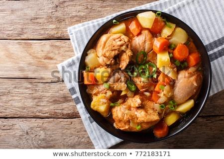 куриные тушеное мясо черный кастрюля домашний брокколи Сток-фото © zhekos