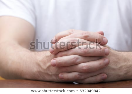business man holding his hand together stock photo © feedough