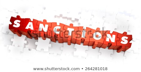 sanctions   word on red puzzles stock photo © tashatuvango