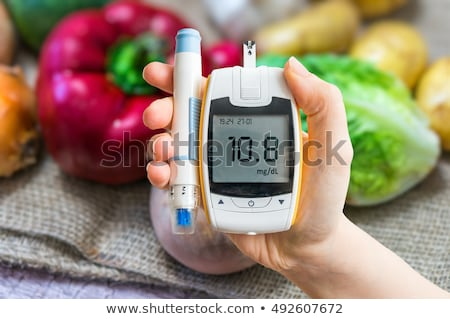 Person Finger With A Glucometer Stock photo © AndreyPopov