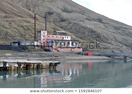 industrial pier in the arctic sea svalbard stock photo © dinozzaver