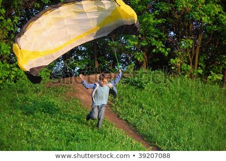 мальчика парашютом работает холме улыбка трава Сток-фото © Paha_L
