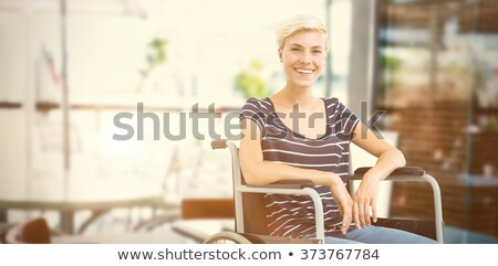 Composite image of smiling woman in a wheelchair Stock photo © wavebreak_media