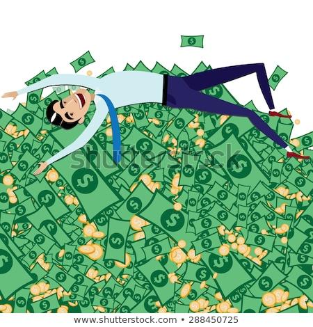 happy businessman lying on big pile of money stock photo © alexanderandariadna