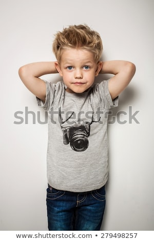Cute little boy with funny hair and cheerful grimace Stock photo © zurijeta