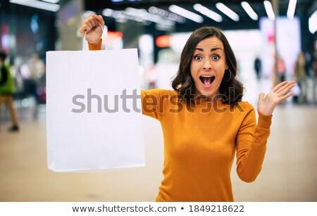 Fiatal nő mutat táska teljes alakos portré gyönyörű nő Stock fotó © filipw