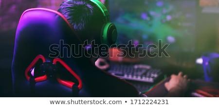 Stock fotó: Férfi · headset · játszik · számítógép · videojáték · otthon