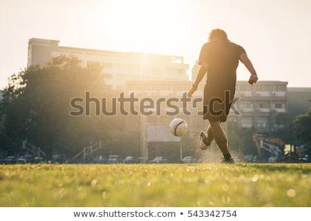 Człowiek gry piłka nożna biały student fitness Zdjęcia stock © bluering
