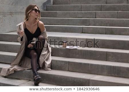 gülen · işkadını · siyah · elbise · oturma · sandalye · tam · uzunlukta - stok fotoğraf © deandrobot