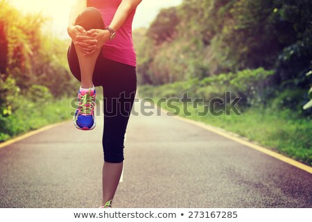 young runner warming up in park stock photo © deandrobot