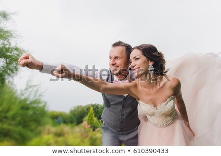 Newlyweds In A Superman Pose Stock fotó © O_Lypa