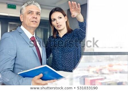 business colleagues looking away seen through glass stock photo © wavebreak_media