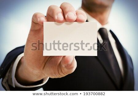 business man showing business card. Black suit and tie. Stock photo © snowing