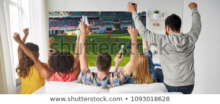 Amis regarder football excité femme bar Photo stock © wavebreak_media