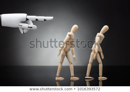 robots hand giving direction to two wooden dummies stock photo © andreypopov