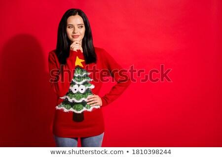 Pensive smiling brunette woman in sweater touching her chin Stock photo © deandrobot