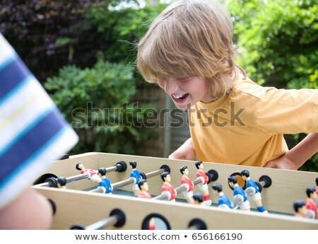 two boys 8 11 playing table football stock photo © is2