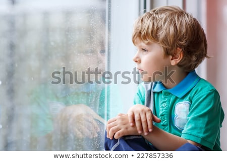 Two boys looking out of window Stock photo © IS2