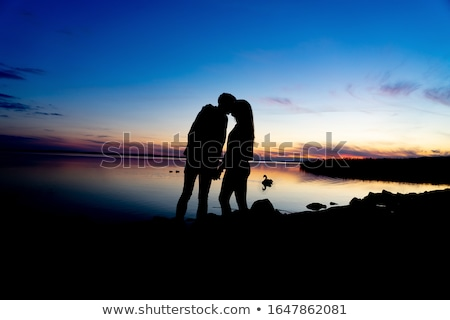 Couple kissing next to the sea Stock photo © IS2