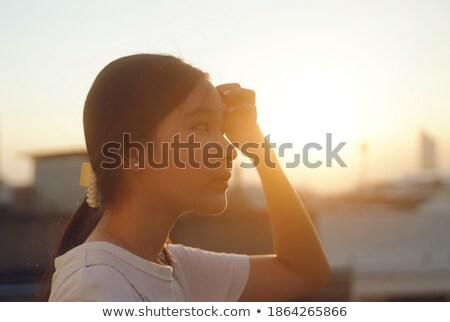 ブルネット 女性 を見て 美しい 日没 ストックフォト © majdansky
