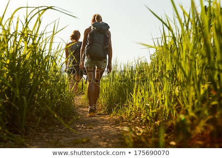 Lady hiker on path Stock photo © backyardproductions