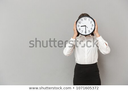 Photo of amusing businesswoman in formal wear covering face with Stock photo © deandrobot
