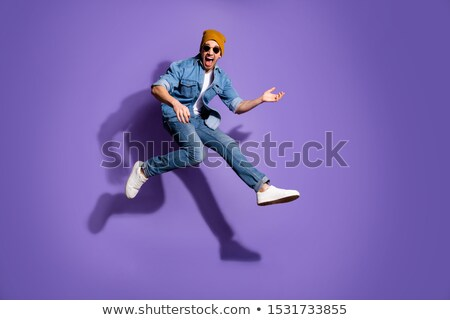 young guitarist jumping to side and screaming Stock photo © feedough