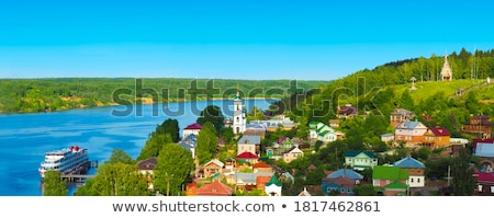 Beautiful countryside landscape picturesque river with ships, green forest with summer sky at sunset Stock photo © artjazz