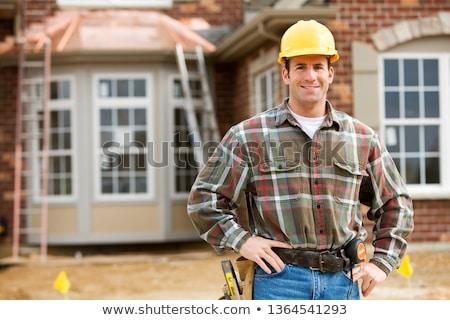 Jonge bouwvakker glimlachend camera nieuwe gebouw Stockfoto © diego_cervo