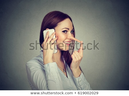 happy liar woman with long nose stock photo © ichiosea