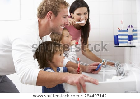 Család fogmosás boldog család anya lánygyermek gyermek Stock fotó © choreograph